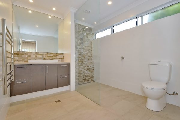 Bathroom renovation with frameless shower screen and feature tile by Mindful Homes Perth