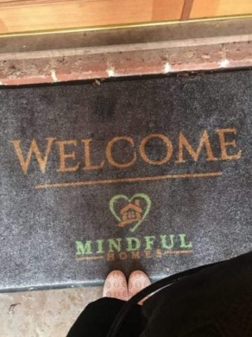 mindful homes written on welcome mat