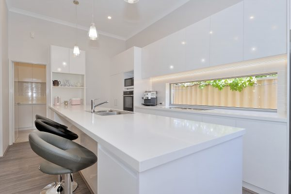 Kitchen renovation with window splashback by Mindful Homes