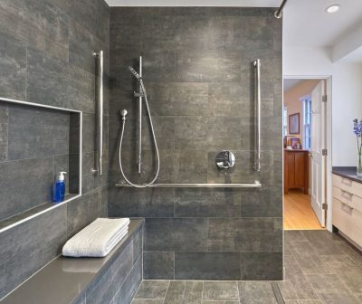 Accessible bathroom with hobless open shower and bench seating and slip-resistant tile by CARNEMARK design + build