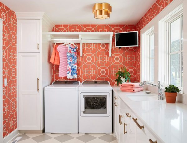 Bright and Colourful Laundry RoomWith Television by Refined LLC