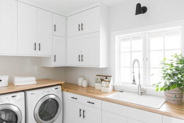 Light and Airy, Modern laundry with timber counter top by Studio McGee